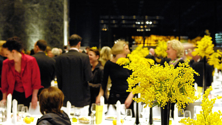 A group of people during an evening event