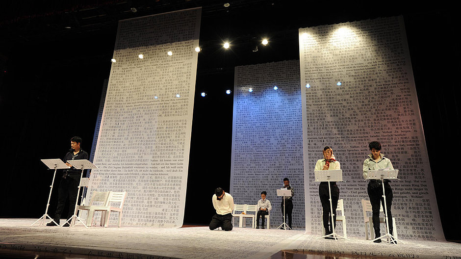 Several people in a staged reading